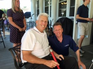 Richard Migliore presents a prize putter to Coach Bill Parcells after Coach wins the putting contest